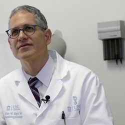 Dr. Ethan Basch speaks during an interview at the North Carolina Cancer Hospital in Chapel Hill, N.C., on Thursday, May 25, 2017. Basch conducted a study that shows cancer patients who use home computers to report problems like nausea and fatigue improved survival _ by nearly half a year, longer than many new cancer drugs do.