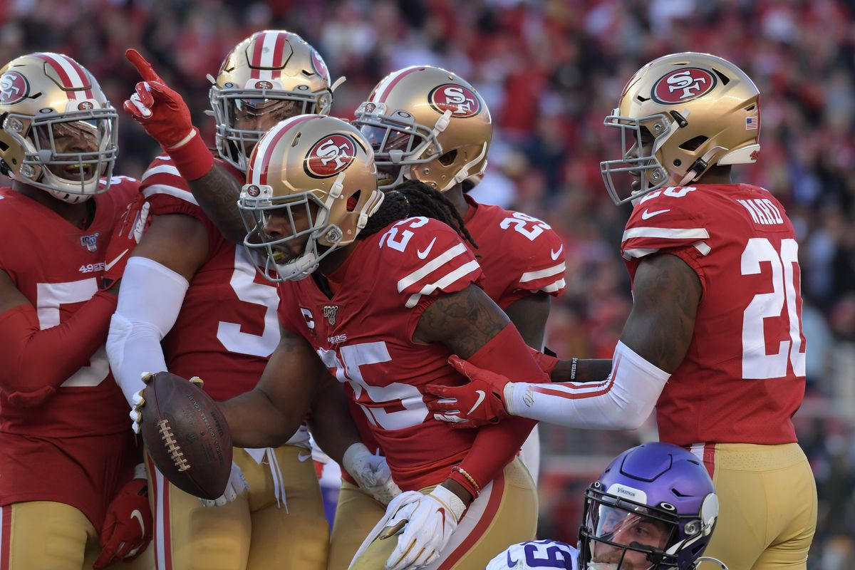 San Francisco 49ers cornerback Richard Sherman celebrates with the defense after intercepting a pass against the Minnesota Vikings during the second half in the NFC Divisional Round playoff football game at Levi's Stadium.