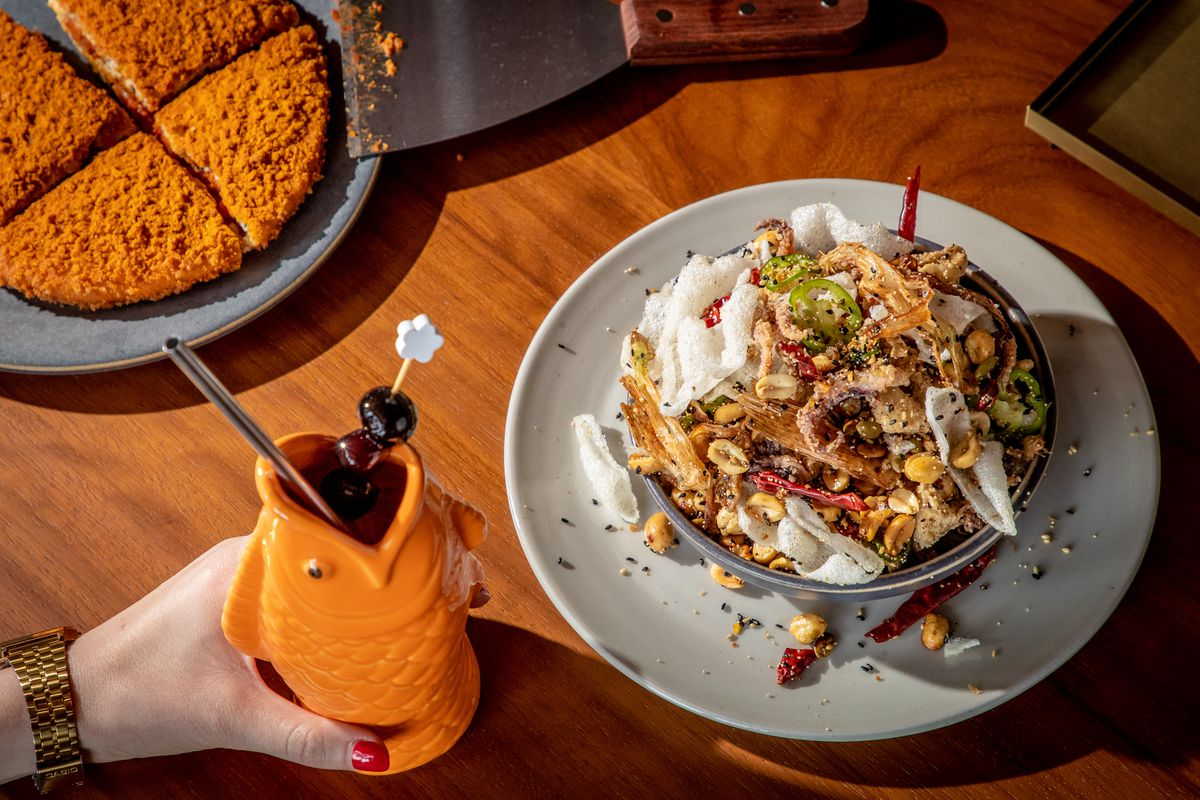 The curry doughnut, the Zombie Elvis drink in an orange fish mug, and the squid seca at Bar Wayo