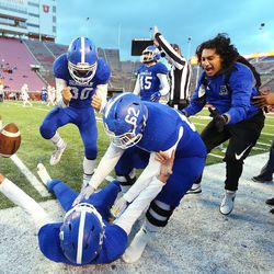 Bingham players celebrate an interception by Bingham's Dax Milne (5) as the game nears its end as Bingham and East play for the 6A football championship at Rice-Eccles Stadium at the University of Utah in Salt Lake City on Friday, Nov. 17, 2017.