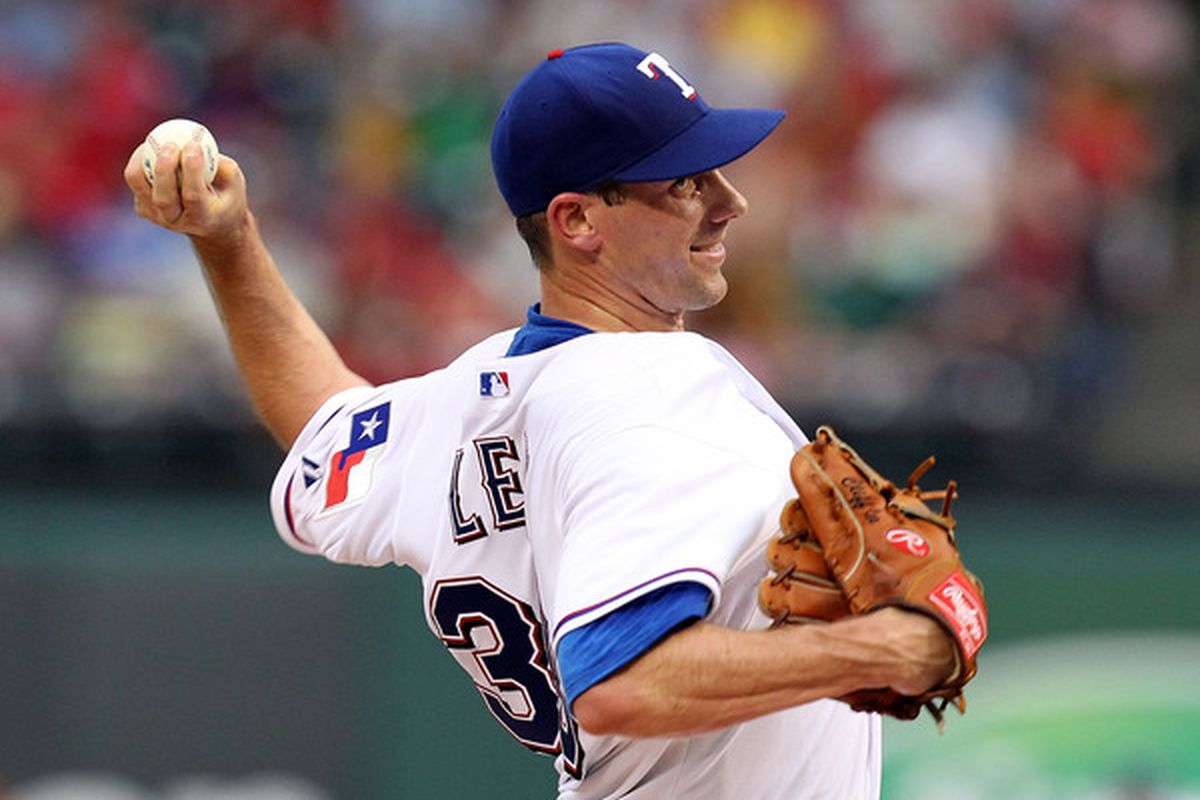 ARLINGTON TX - JULY 10:  Pitcher Cliff Lee #33 of the Texas Rangers throws against the Baltimore Orioles on July 10 2010 at Rangers Ballpark in Arlington Texas.  (Photo by Ronald Martinez/Getty Images)