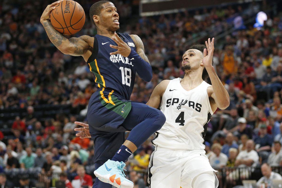 Utah Jazz guard Jairus Lyles (18) goes to the basket as San Antonio Spurs guard Derrick White (4) defends during the second half of an NBA summer league basketball game Monday, July 2, 2018, in Salt Lake City. (AP Photo/Rick Bowmer)