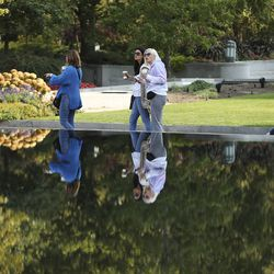 Visitors walk on Temple Square during the 190th Semiannual General Conference of The Church of Jesus Christ of Latter-day Saints in Salt Lake City on Saturday, Oct. 3, 2020.