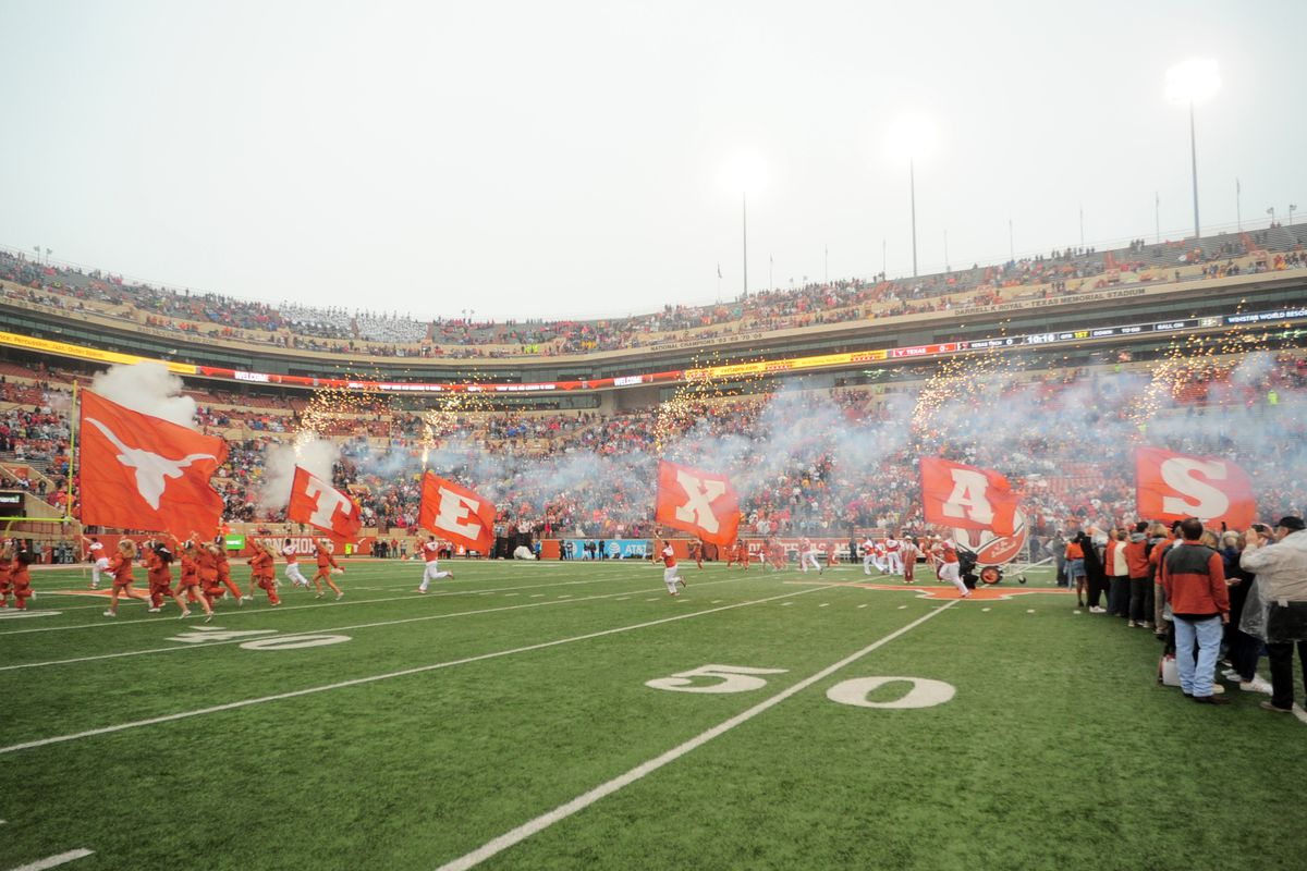 The Texas Longhorns spirit squad leads out the team prior to game against the Texas Tech Red Raiders on November 29, 2019 at Darrell K Royal-Texas Memorial Stadium in Austin, Texas.
