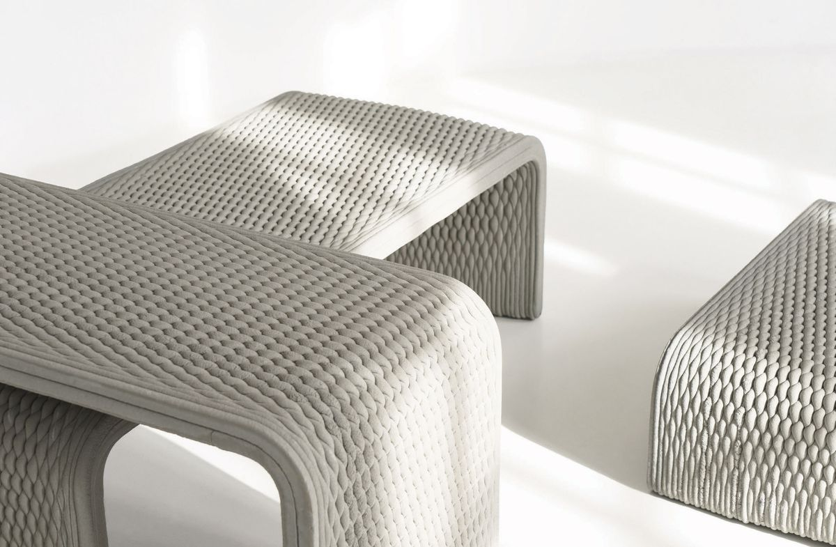 Three concrete benches with woven pattern