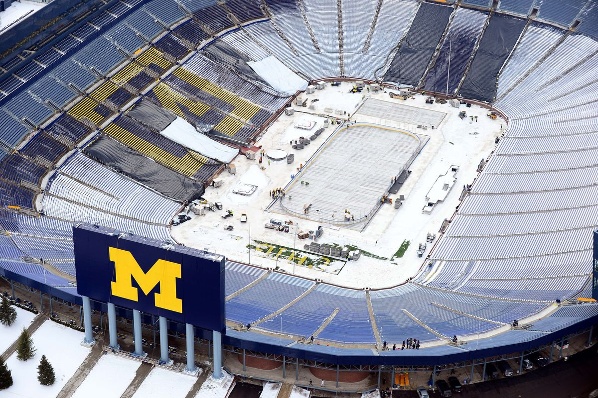 An aerial view of Michigan Stadium during rink construction.