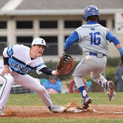 Layton's Gage Sundloff, left, tries to make the catch as Bingham's Jake Mortensen steps on first base as they play a baseball game in Layton on Tuesday, March 23, 2021.