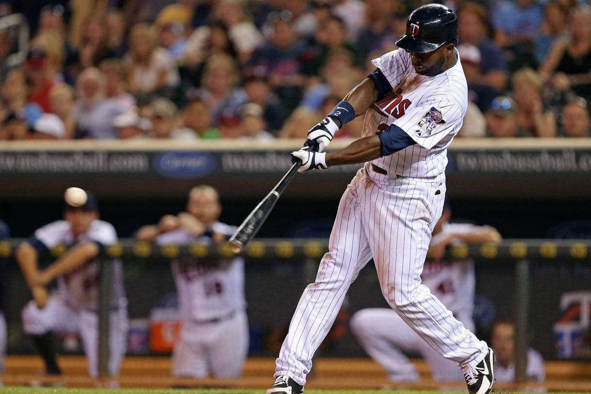 July 31, 2012; Minneapolis, MN, USA: Minnesota Twins center fielder Denard Span (2) hits a RBI single in the ninth inning against the Chicago White Sox at Target Field. The White Sox won 4-3. Mandatory Credit: Jesse Johnson-US PRESSWIRE