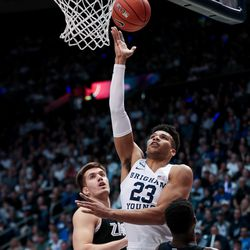 Brigham Young Cougars forward Yoeli Childs (23) goes to the hoop between Gonzaga Bulldogs forward Filip Petrusev (3) and guard Joel Ayayi (11) at the Marriott Center in Provo on Saturday, Feb. 22, 2020.