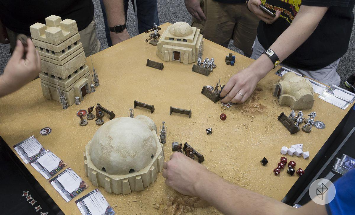 Gen Con 2017 - hands reach into a diorama of Tatooine from Star Wars: Legion