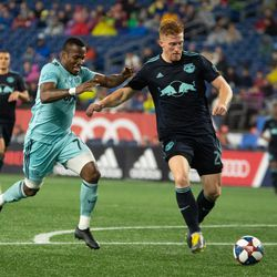 FOXBOROUGH, MA - APRIL 20: New England Revolution forward Cristian Penilla #70 and New York Red Bulls defender Tim Parker #26 battle for the ball at Gillette Stadium on April 20, 2019 in Foxborough, Massachusetts. (Photo by J. Alexander Dolan - The Bent Musket)