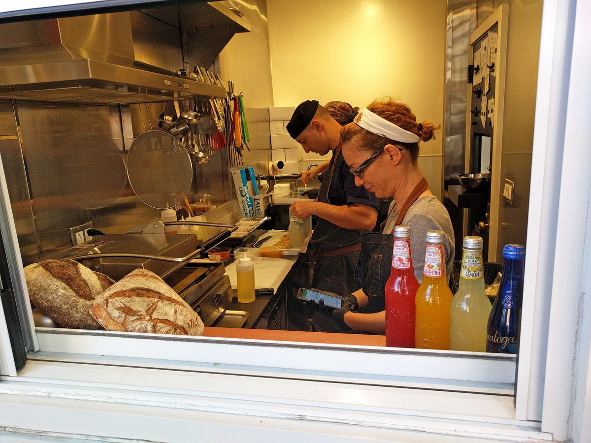 A look inside the kitchen, where three are seen working...