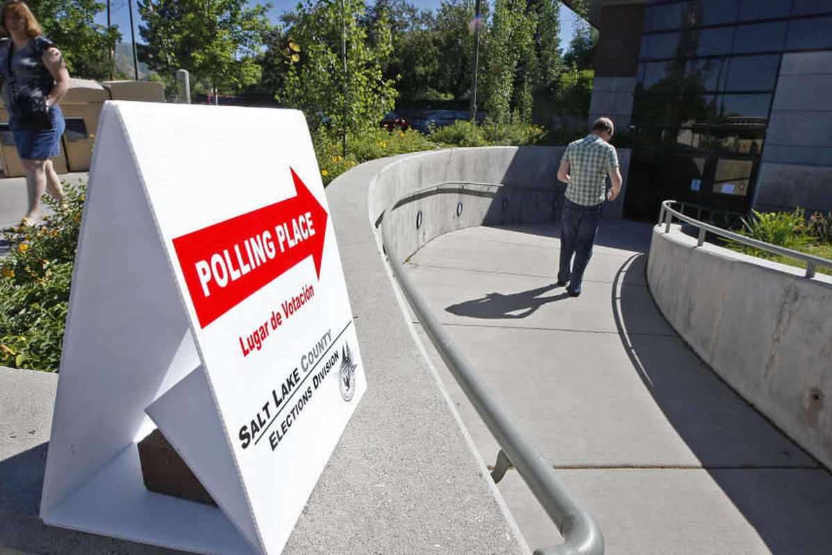 Signs for voting on Utah\'s primary day at the Anderson-Foothill Library branch Tuesday, June 26, 2012, in Salt Lake City, Utah.