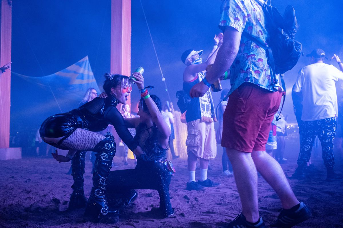 Festival goers dance as Wenzday performs at the Spring Awakening Musical Festival: Autumn Equinox.