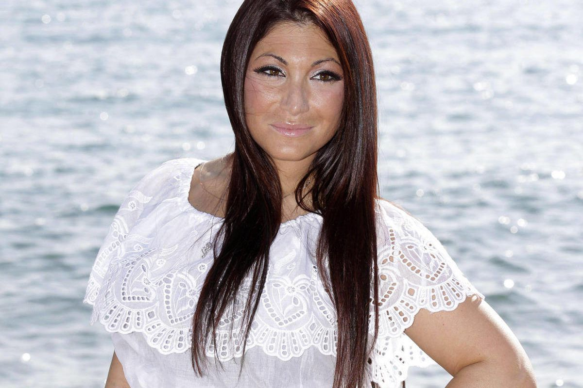 """FILE - This April 1, 2012 file photo shows Deena Nicole Cortese, a cast member on the MTV reality series """"Jersey Shore""""  posing for photographers during the MIPTV, International Television Programme Market, in Cannes, southern France. New Jersey's Divisio"""