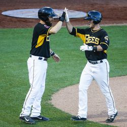 Salt Lake Bees shortstop Matt Williams (7) celebrates a home run with second baseman Dustin Ackley (6) during a game against the Las Vegas 51s at Smith's Ballpark in Salt Lake City on Monday, June 5, 2017.