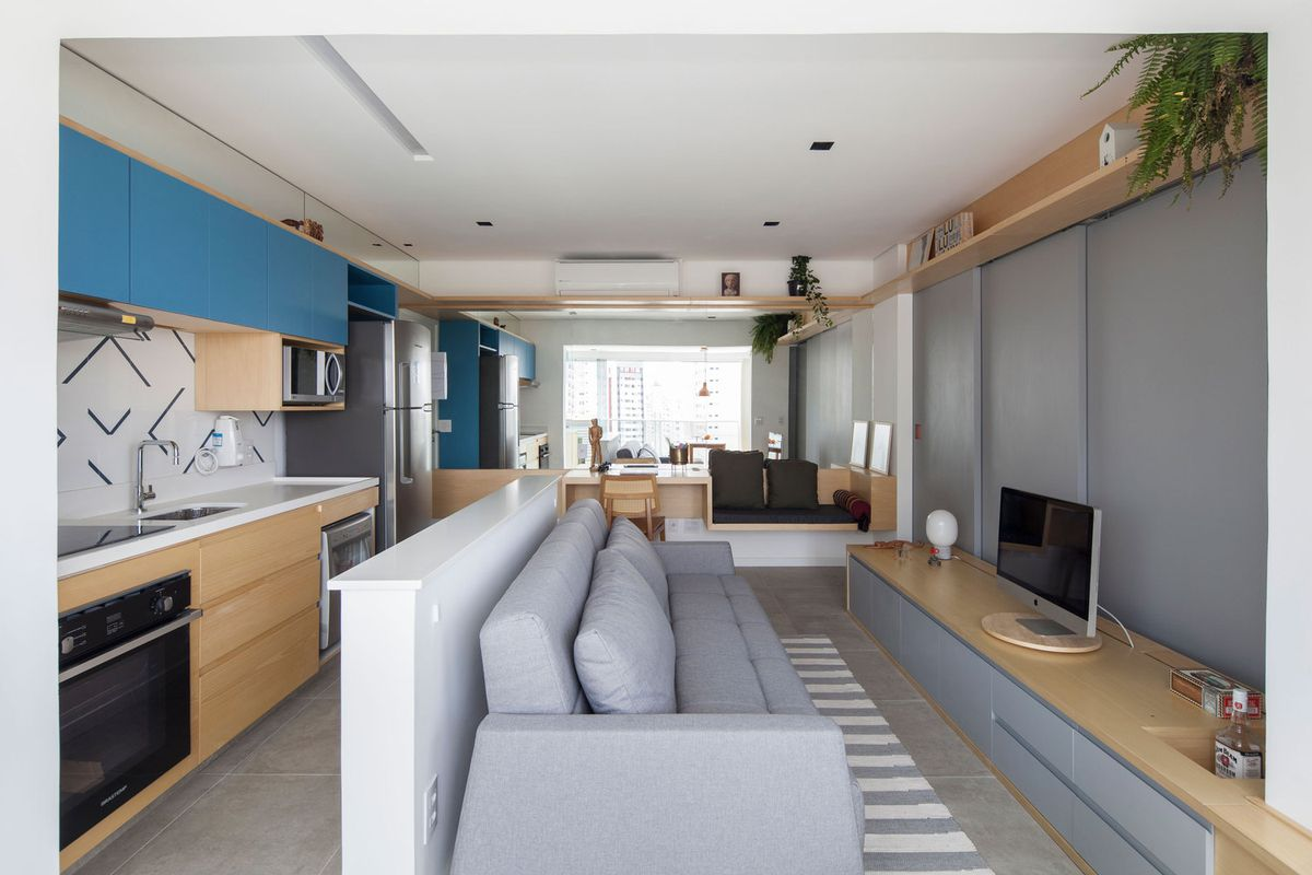 Efficient Tiny Apartment Lives Large With Clever Built Ins