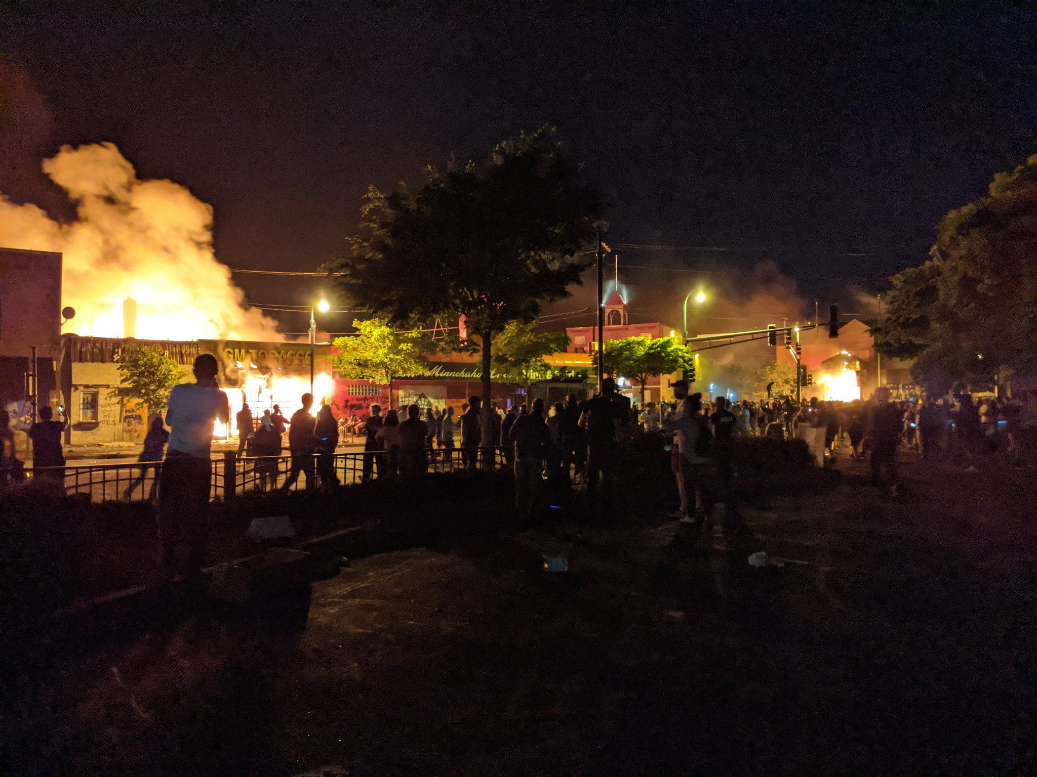 The Minneapolis Third Precinct police station was evacuated late Thursday night and then was engulfed in flames. Protesters cheered and lit fireworks to celebrate.