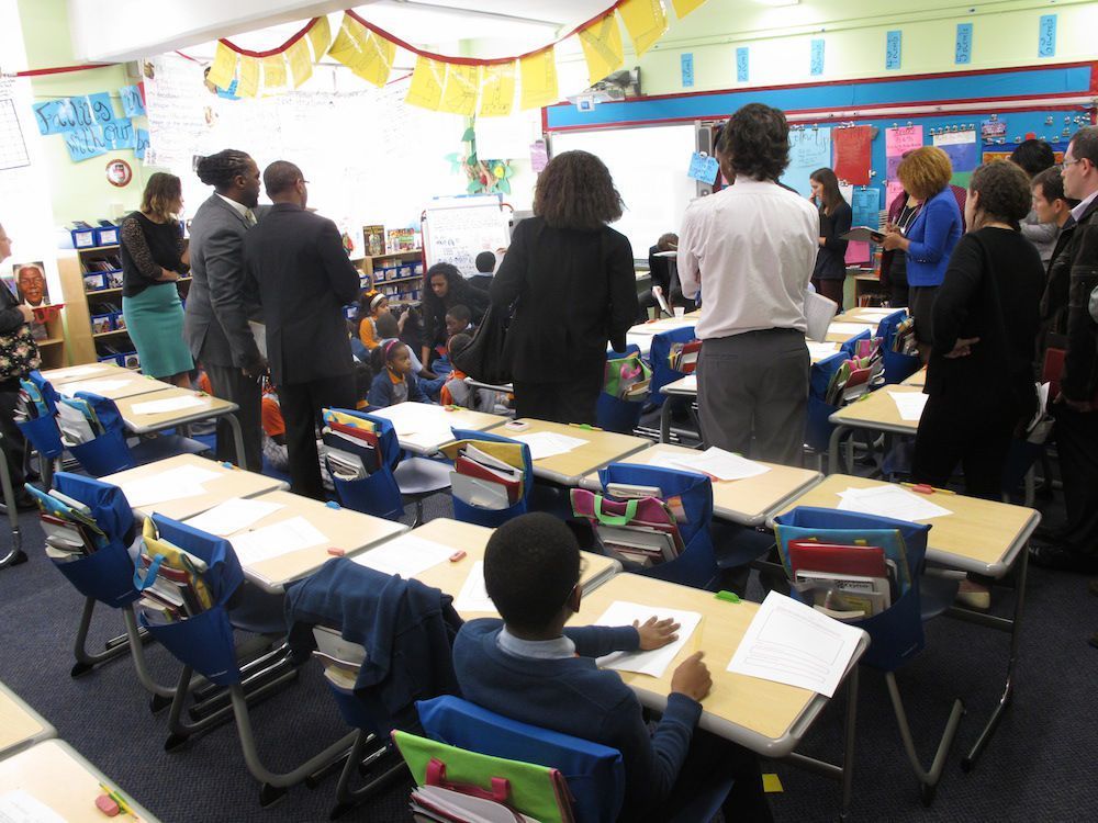 Discipline on display: A student was told to stay seated while the rest of hisclassmates moved to the rug to work on a math problem on the rug.