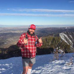 Mark Robbins celebrates one of his six summits.