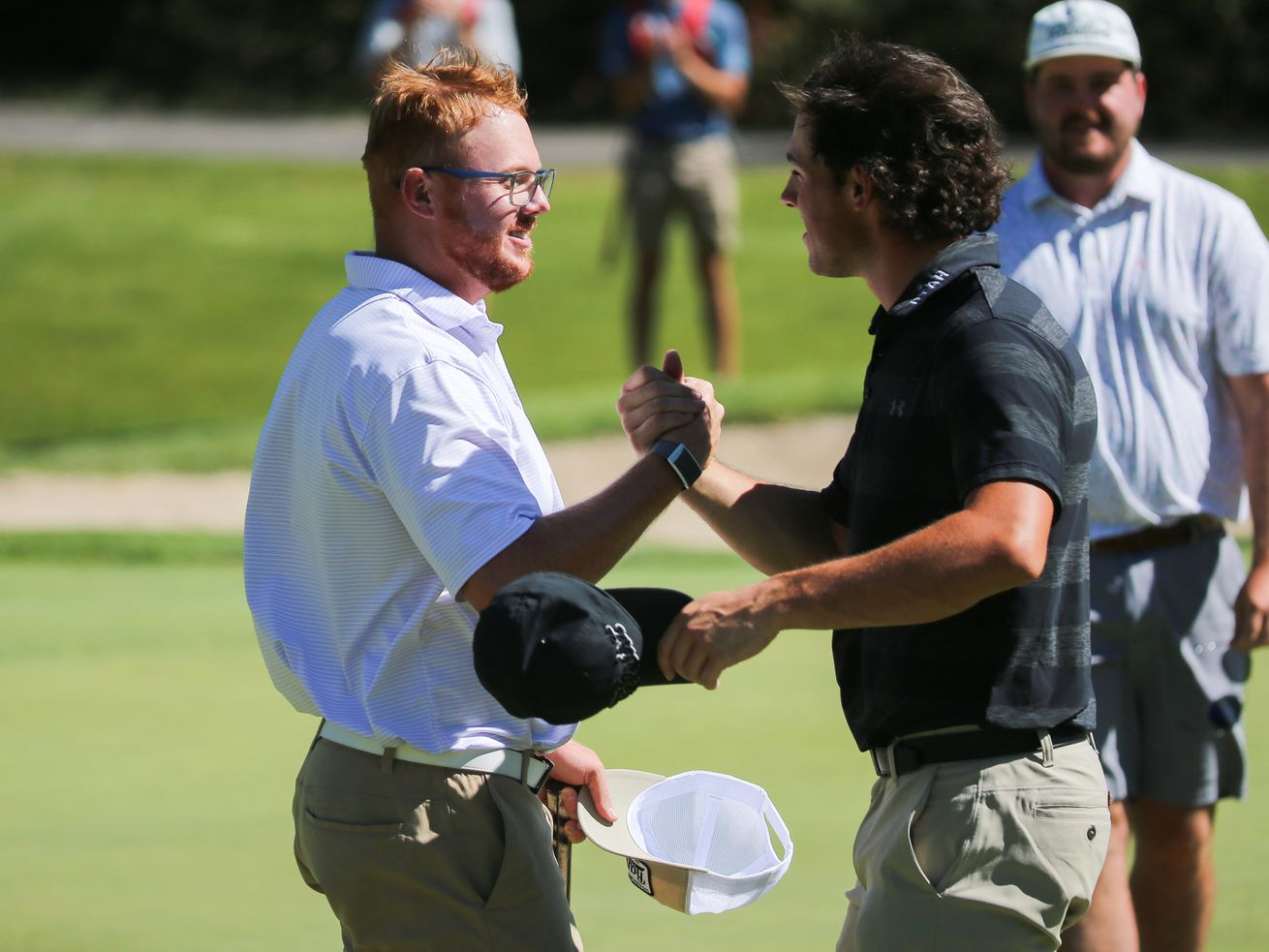 Mitchell Schow, left, is congratulated by Blake Tomlinson after the Utah State Amateur finals at Jeremy Ranch Golf & Country Club in Park City on Saturday, Sept. 5, 2020. Schow won the tournament.