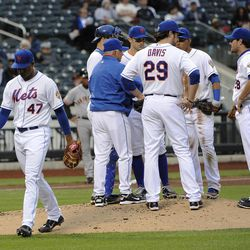New York Mets pitcher Miguel Batista (47) heads to the dugout after being taken out of the game by manager Terry Collins in the fourth inning of the first game of a baseball doubleheader against San Francisco Giants on Monday, April 23, 2012, in New York.