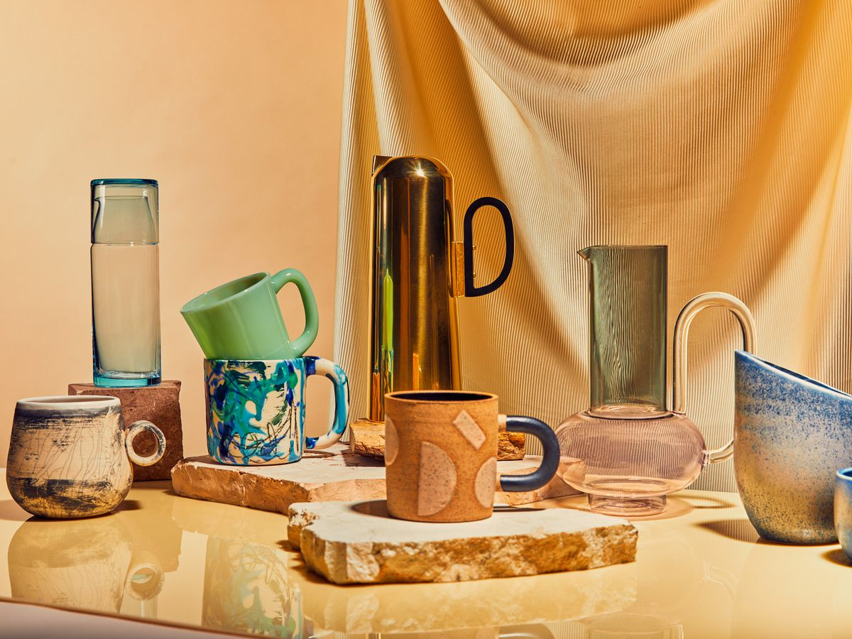 An array of ceramic and glass mugs and pitchers