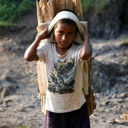 Children in rural Guatemala are often pulled out of school to help gather wood.