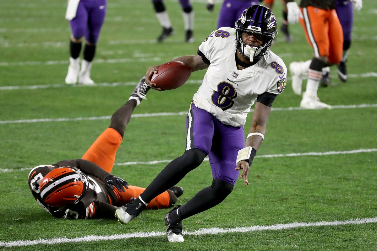 Lamar Jackson #8 of the Baltimore Ravens scores a touchdown during the second quarter in the game against the Cleveland Browns at FirstEnergy Stadium on December 14, 2020 in Cleveland, Ohio.