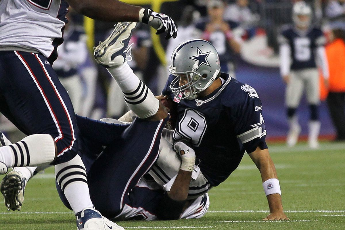 FOXBORO, MA - OCTOBER 16:   Tony Romo #9 of the Dallas Cowboys is sacked in the second half against the New England Patriots at Gillette Stadium on October 16, 2011 in Foxboro, Massachusetts. The Patriots won 20-16. (Photo by Jim Rogash/Getty Images)