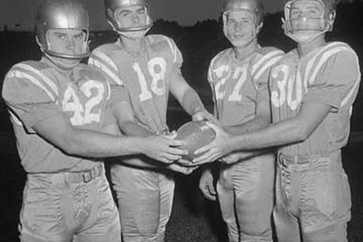 """via <a href=""""http://members.cox.net/mbordelon4/ucla55.jpg"""">members.cox.net</a>  Ronnie Knox (#18) poses with the rest of the UCLA backfield."""