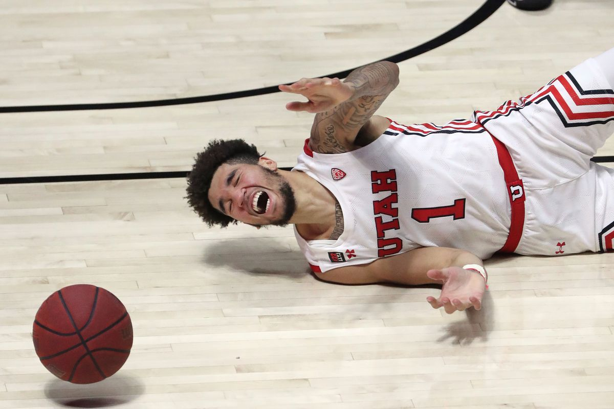 Utah Utes forward Timmy Allen (1) falls and loses the ball during a men's basketball game against the Colorado Buffaloes at the Huntsman Center in Salt Lake City on Monday, Jan. 11, 2021. Utah lost 58-65.