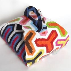 """Potter and retail maven <b>Jonathan Adler</b> went the colorful route, decking out his Cronut™ carrier in bright, bold shades of red, orange, blue, yellow, green and pink. [<a href=""""http://www.biddingowl.com/Auction/item-detail.cfm?auctionID=481&ItemID=18"""