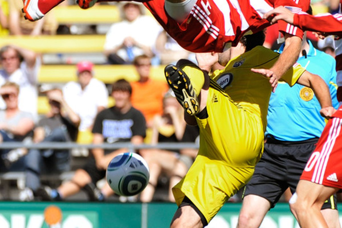 COLUMBUS OH - AUGUST 28:  Eric Alexander #24 of FC Dallas is upended by Adam Moffat #22 of the Columbus Crew while battling for the ball on August 28 2010 at Crew Stadium in Columbus Ohio.  (Photo by Jamie Sabau/Getty Images)