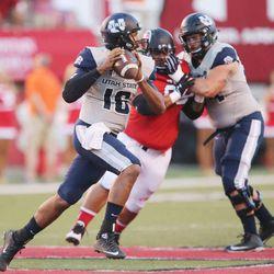 Utah State Aggies quarterback Chuckie Keeton (16) looks to throw against Utah in Salt Lake City Friday, Sept. 11, 2015. Utah won 24-14.