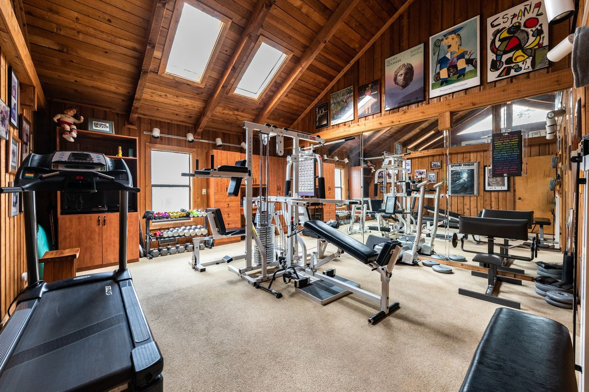 A huge home gym space with skylights.