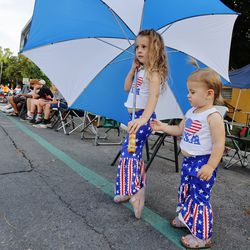 Lulu Carlisle, 4, and her sister Penney Carlisle, 1, watch runners during the Deseret News Marathon and Half Marathon in Salt Lake City on Friday, July 23, 2021.