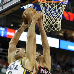 Utah Jazz center Enes Kanter (0) and Portland Trail Blazers center Robin Lopez (42) fight for a rebound in the second half of a game at the Energy Solutions Arena on Wednesday, October 16, 2013.