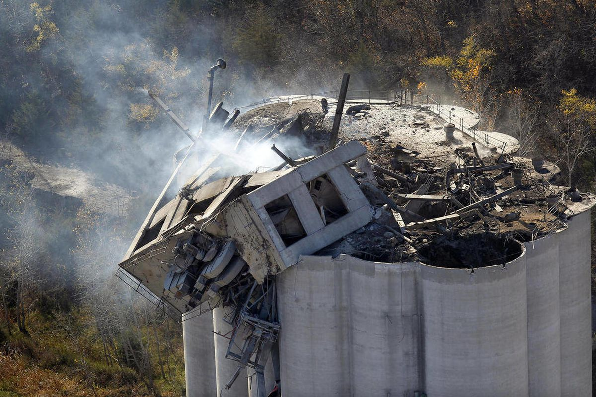 FILE - In this Oct. 30, 2011, file photo smoke rises from the damaged headhouse of the Bartlett Grain elevator in Atchison, Kan. The federal government cited the Missouri grain company Thursday, April 12, 2012, for willful safety violations and proposed a