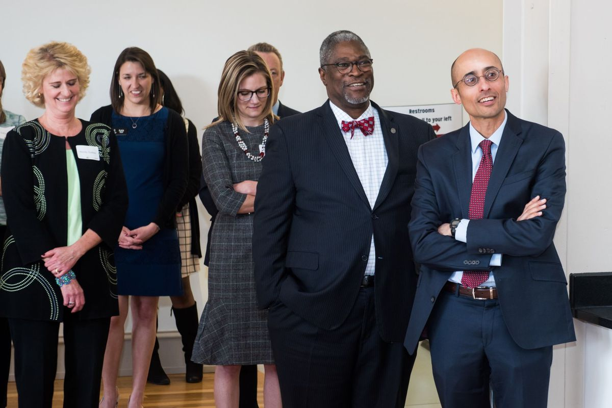 At SchoolSmart Kansas City's launch in April, Awais Sufi, right, stands next to Kansas City Mayor Sly James and Kaufman Foundation President Wendy Guillies (far left).