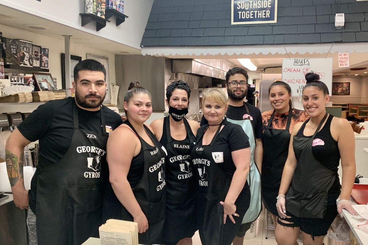 George's Gyros owner Elaine Sakellariou (with mask) pictured with staff on Friday, the first day of Illinois' Phase 4 reopening.