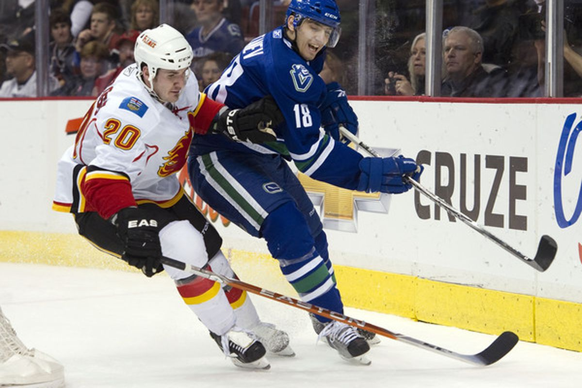 Chris Tanev has been a pleasant surprise in his time up with the Canucks, but the Moose could sure use him too.  (Photo by Rich Lam/Getty Images)