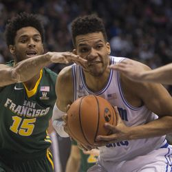 Brigham Young Cougars forward Yoeli Childs (23) takes the ball to the basket while guarded by San Francisco Dons forward Nate Renfro (15) during BYU's 75-73 overtime win at the Marriott Center in Provo on Saturday, Feb. 10, 2018.