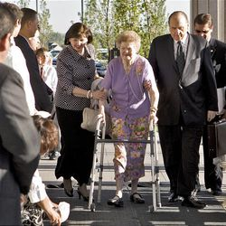 Ann Dibb, left, and President Thomas S. Monson, right, assist Sister Frances Monson as they arrive for the cornerstone ceremony for the new Oquirrh Mountain Temple in West Jordan Friday.