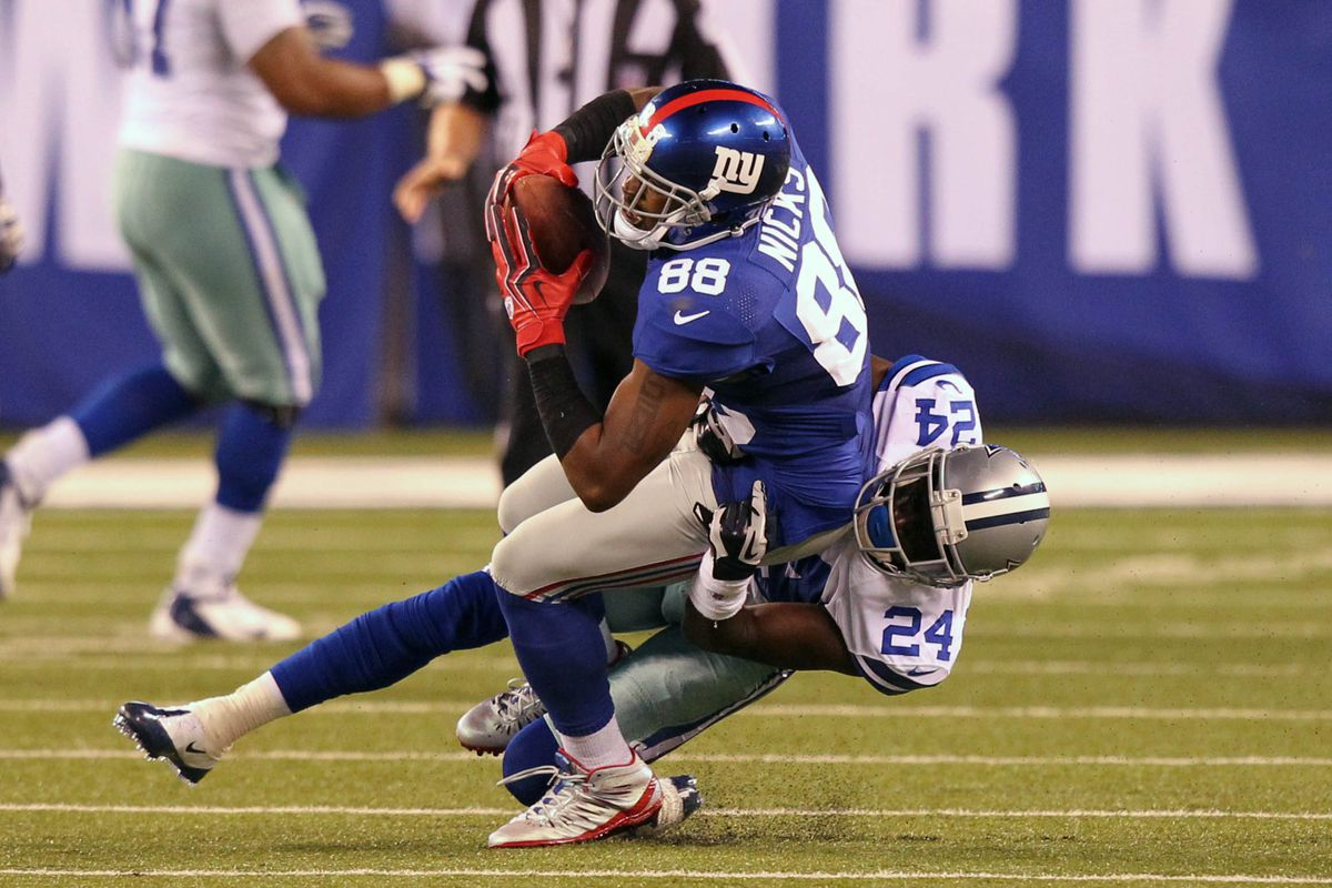 Sep 5, 2012; East Rutherford, NJ, USA; Dallas Cowboys cornerback Morris Claiborne (24) tackles New York Giants wide receiver Hakeem Nicks (88) during the third quarter at MetLife Stadium. Anthony Gruppuso-US PRESSWIRE