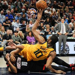 Houston Rockets guard Eric Gordon (10) and Utah Jazz guard Alec Burks (10) battle for the ball in the second half as the Utah Jazz host the Houston Rockets at Vivint Smart Home Arena in Salt Lake on Thursday, Dec. 7, 2017.