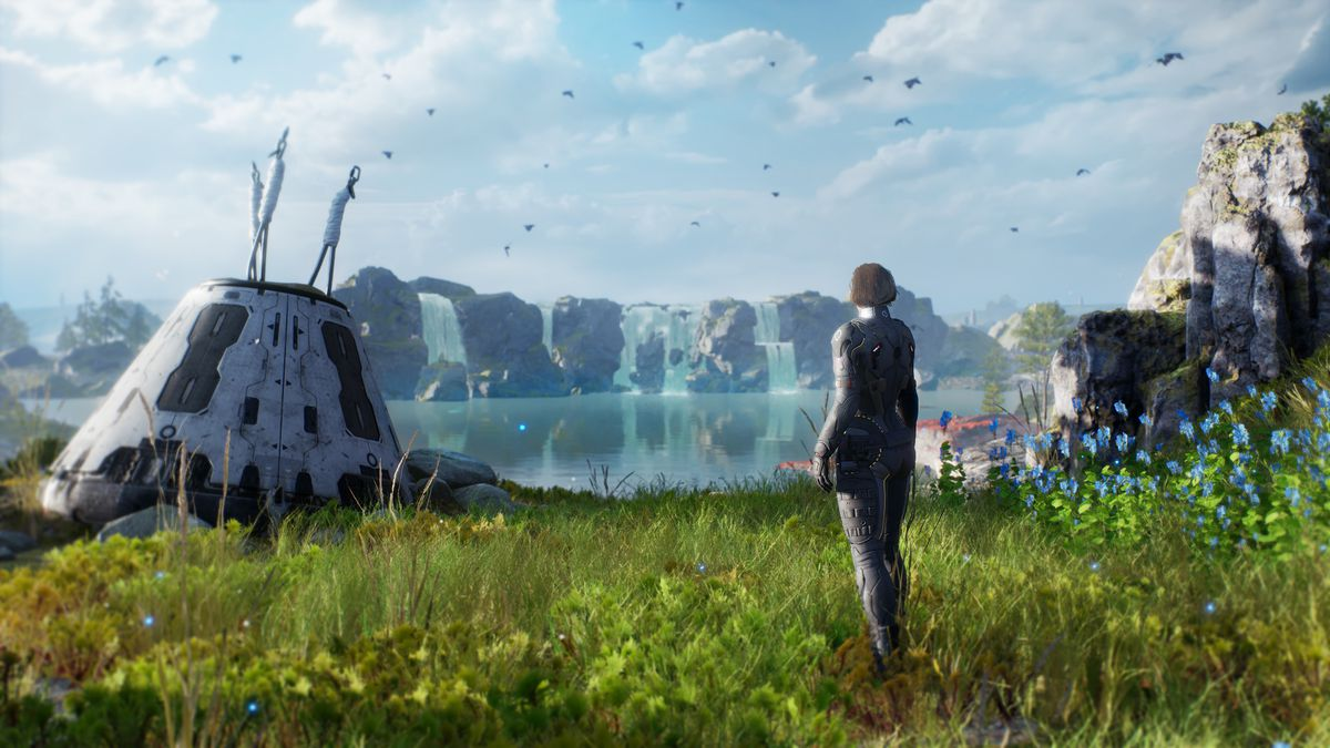 A futuristic settler overlooks a lush, blue-skied alien world called Enoch in a screenshot from Outriders