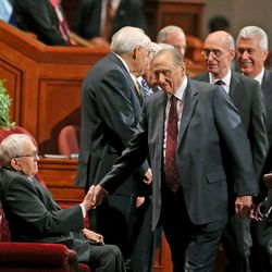 President Thomas S. Monson, right, shakes hands with President Boyd K. Packer, the President of the Quorum of the Twelve Apostles of The Church of Jesus Christ of Latter-day Saints talks during the afternoon session of the 183rd Semiannual General Conference of the Church of Jesus Christ of Latter-day Saints Saturday, Oct. 5, 2013, in Salt Lake City.
