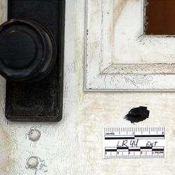 A bullet hole marked in the front door of the home at 3268 Jackson Avenue in Ogden, Tuesday, Jan. 10, 2012.