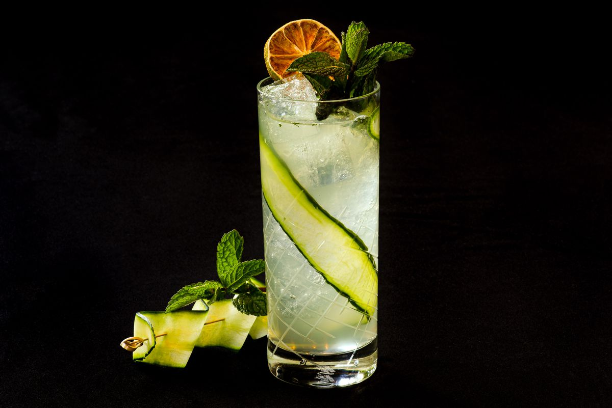 A cocktail with a cucumber